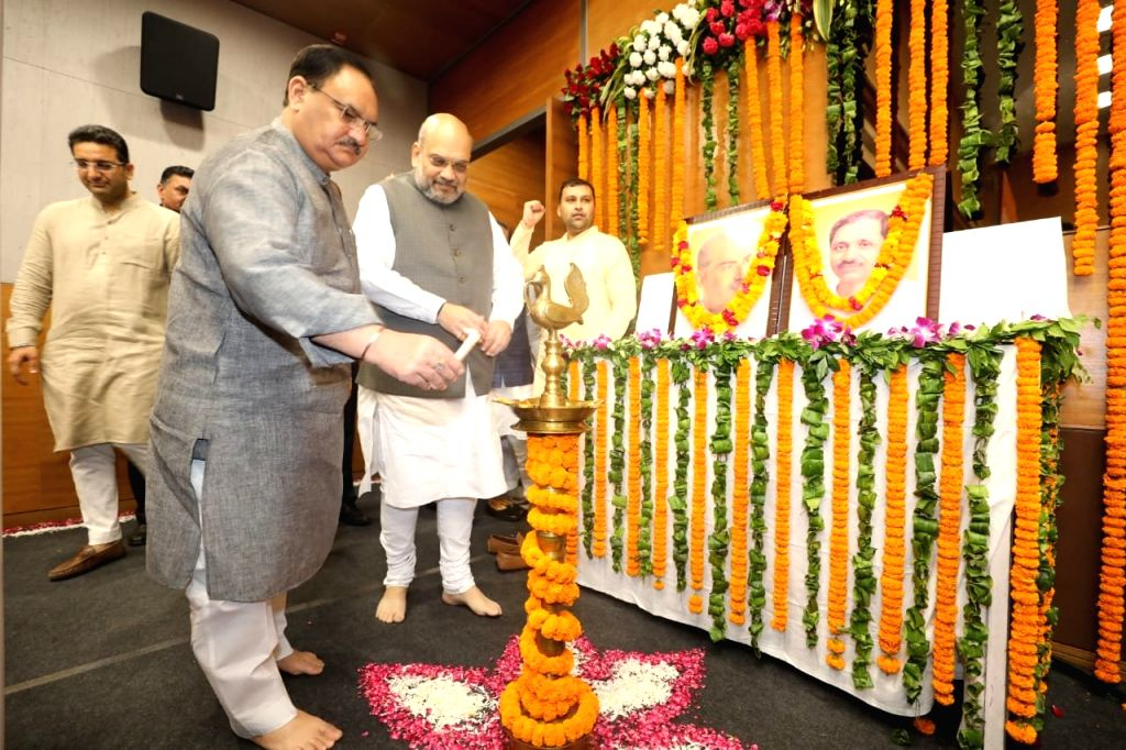 Union Home Minister Amit Shah and BJP National Working President J.P. Nadda at the inauguration of an exhibition on the life and works of Prime Minister Narendra Modi, at the BJP ... - Amit Shah and Narendra Modi