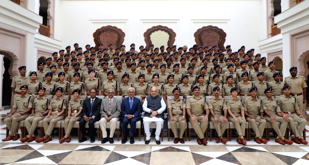 Union Home Minister Amit Shah and Home Secretary Ajay Kumar Bhalla with the Probationers of 2018 Batch of Indian Police Service (IPS), in New Delhi on Oct 7, 2019. - Amit Shah