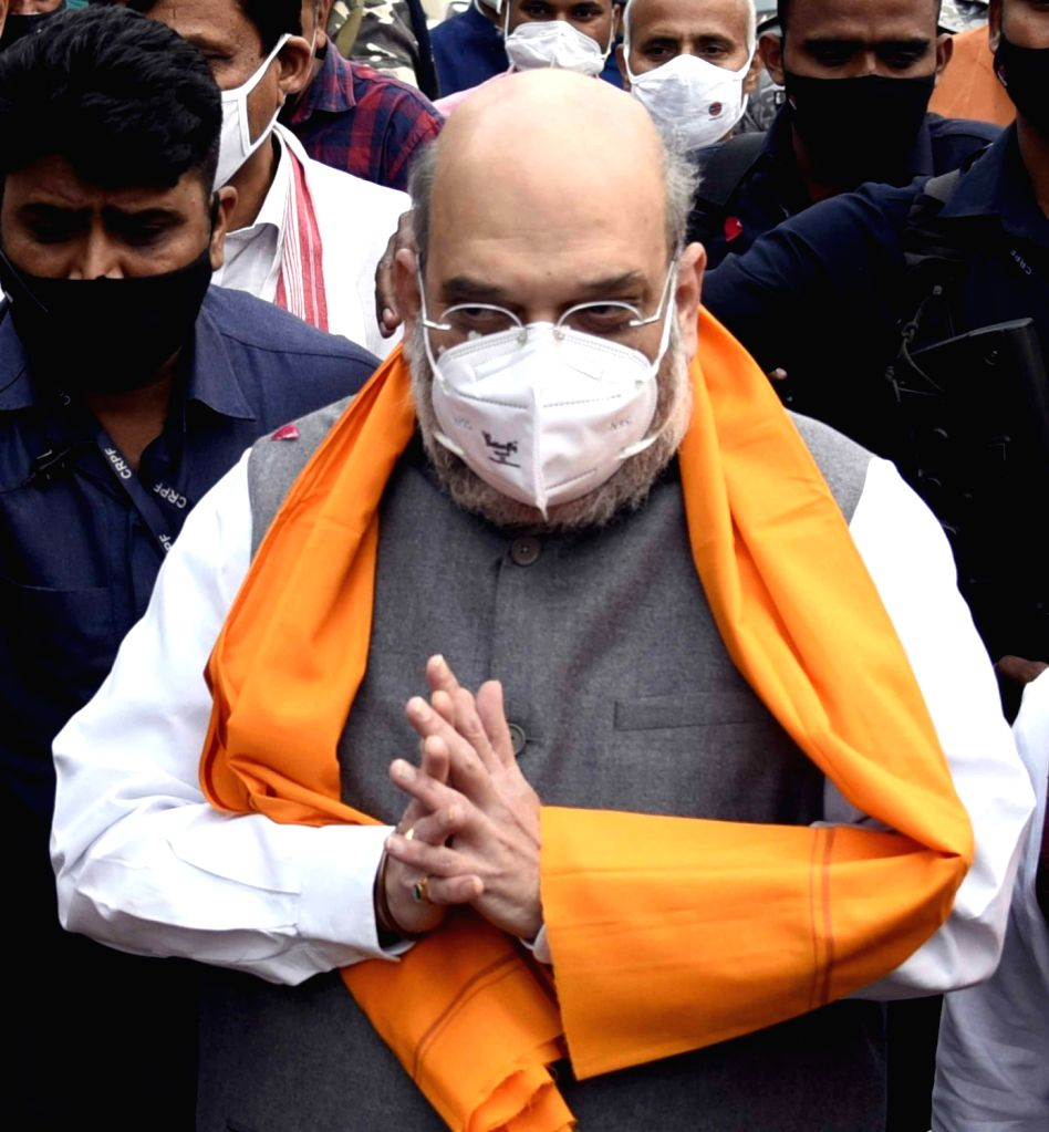 Union Home Minister Amit Shah arrives at Jaiprakash Narayan International Airport in Patna to attend the swearing-in-ceremony of Nitish Kumar, on Nov 16, 2020. - Amit Shah and Nitish Kumar