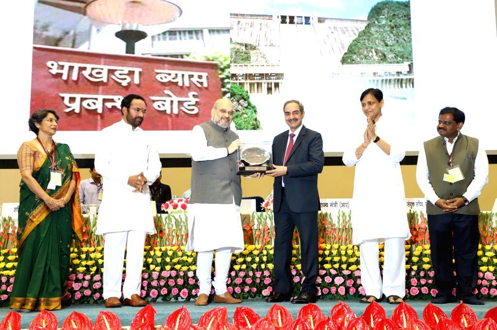 Union Home Minister Amit Shah awards Rajbhasha Gaurav Puraskar and Rajbhasha Kirti Puraskar, at the Hindi Divas Samaroh 2019, in New Delhi on Sep 14, 2019. Also seen Ministers of State for ... - Amit Shah, Nityanand Rai and G. Kishan Reddy