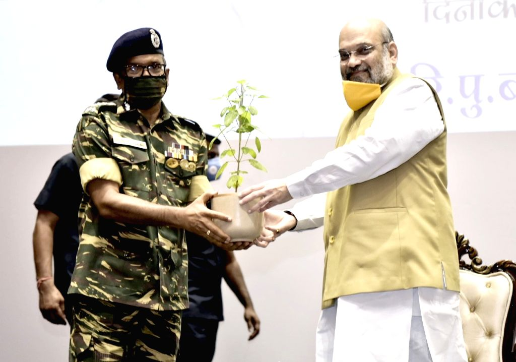 Union Home Minister Amit Shah being felicitated by CRPF DG A.P. Maheshwari at the launch of the nationwide tree plantation drive by the Central Armed Police Forces (CAPFs) at CRPF Camp in ... - Amit Shah