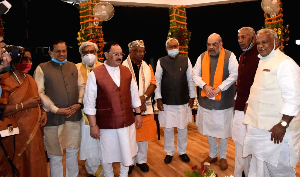 Union Home Minister Amit Shah, BJP National President JP Nadda and Bihar Governor Phagu Chauhan with the newly sworn-in Bihar Chief Minister Nitish Kumar and his Cabinet, in Patna on Nov 16, ... - Amit Shah, Phagu Chauhan and Nitish Kumar