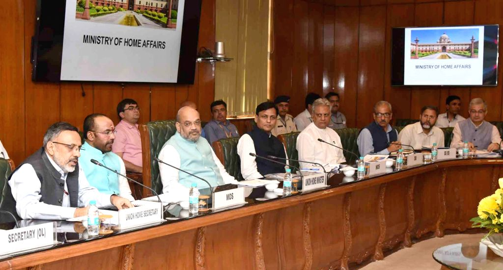 Union Home Minister Amit Shah chairs a review meeting with the senior officers of Ministry of Home Affairs (MHA), in New Delhi on June 01, 2019. Also seen Union Ministers of State for Home ... - Amit Shah, G. Kishan Reddy, Nityanand Rai and Rajiv Jain