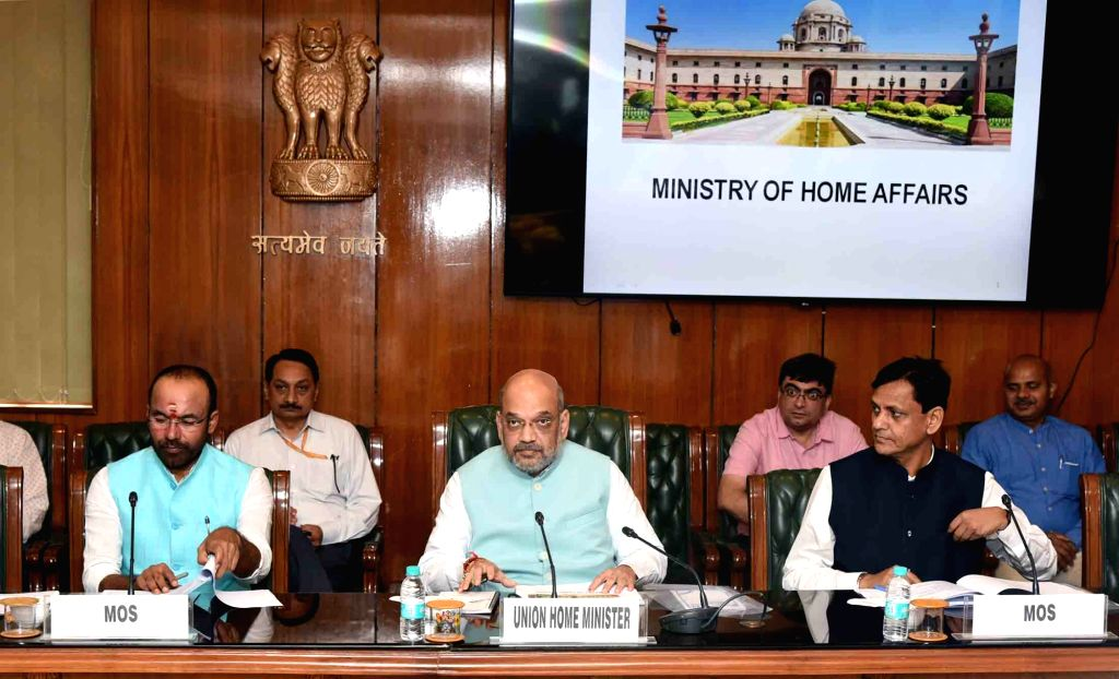 Union Home Minister Amit Shah chairs a review meeting with the senior officers of Ministry of Home Affairs (MHA), in New Delhi on June 01, 2019. Also seen Union Ministers of State for Home ... - Amit Shah, G. Kishan Reddy and Nityanand Rai