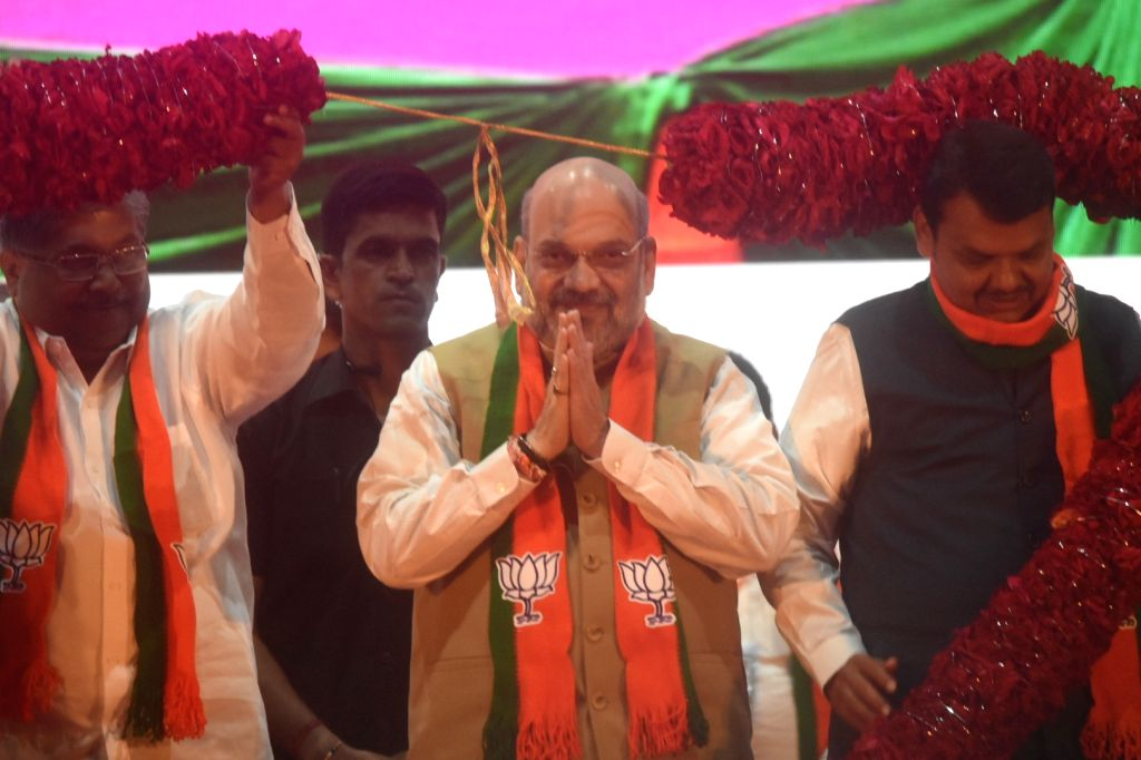 Union Home Minister Amit Shah during a seminar on Abrogation of Article 370 from J&K in Mumbai on Sep 22, 2019. Also seen Maharashtra Chief Minister Devendra Fadnavis. - Amit Shah