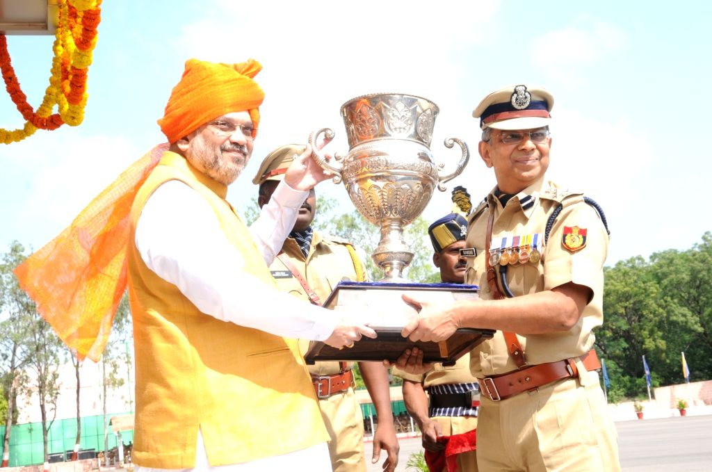 Union Home Minister Amit Shah felicitates IPS Suvashish Chaudhary with Prime Minister's Cup. - Amit Shah and Suvashish Chaudhary