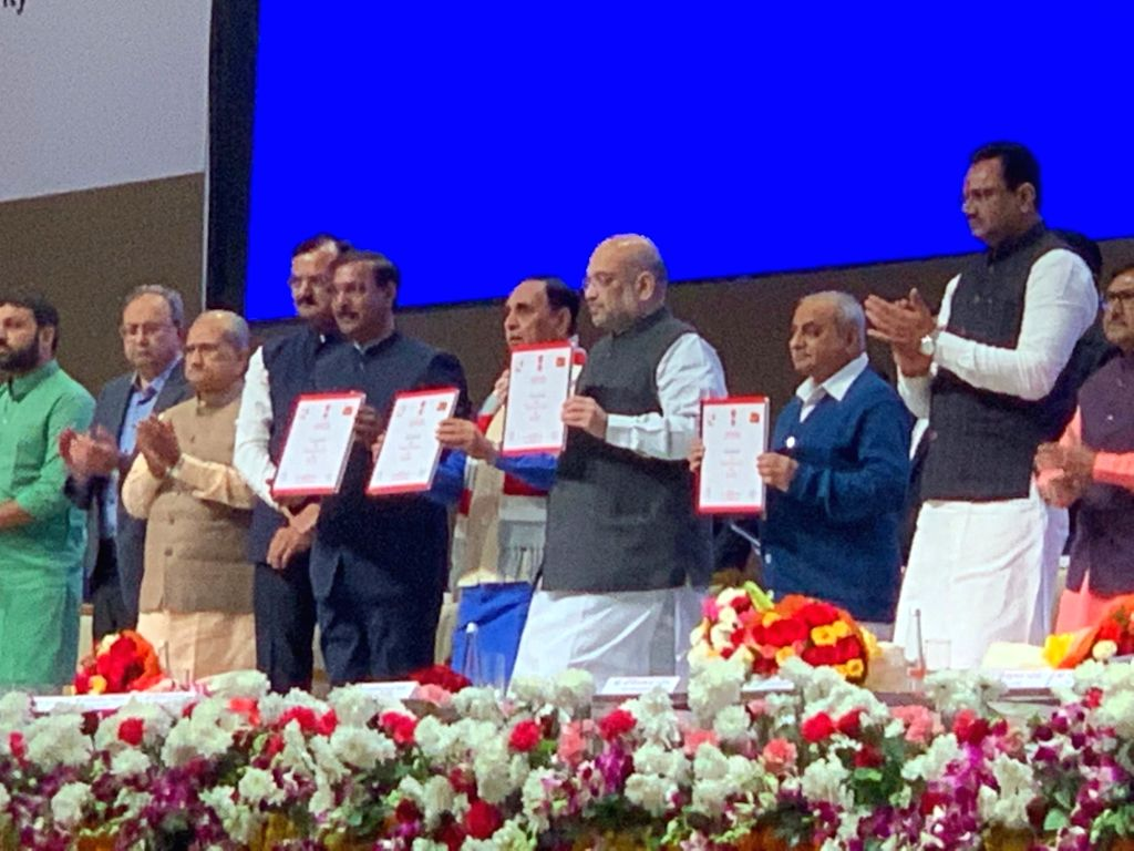 Union Home Minister Amit Shah, Gujarat Chief Minister Vijay Rupani, Deputy Chief Minister Nitinbhai Patel and other dignitaries at the launch of public safety programmes of Gujarat Home ... - Amit Shah and Nitinbhai Patel