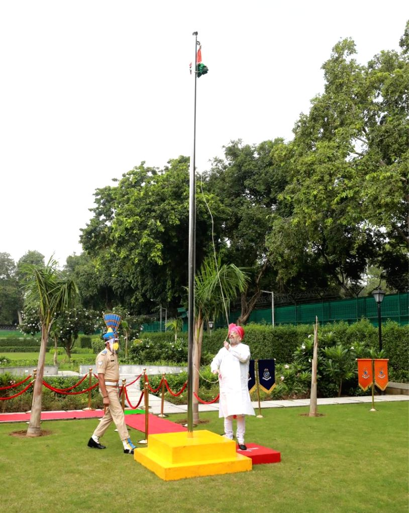 Union Home Minister Amit Shah hoisting the national flag on the occasion of 74th Independence Day, in New Delhi on Aug 15, 2020. - Amit Shah