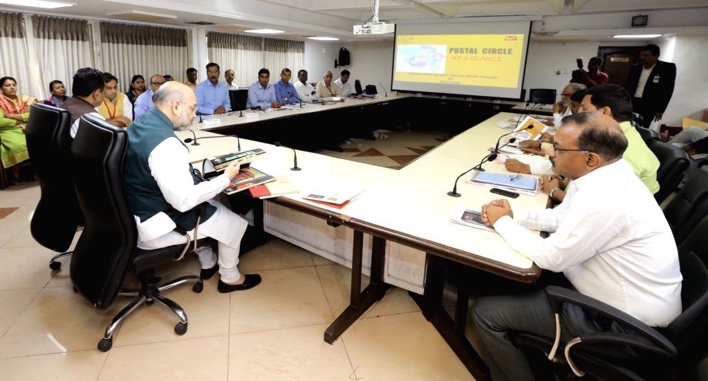 Union Home Minister Amit Shah holds a meeting with the officials of Postal and Railway Department, in Ahmedabad on Oct 26, 2019. - Amit Shah