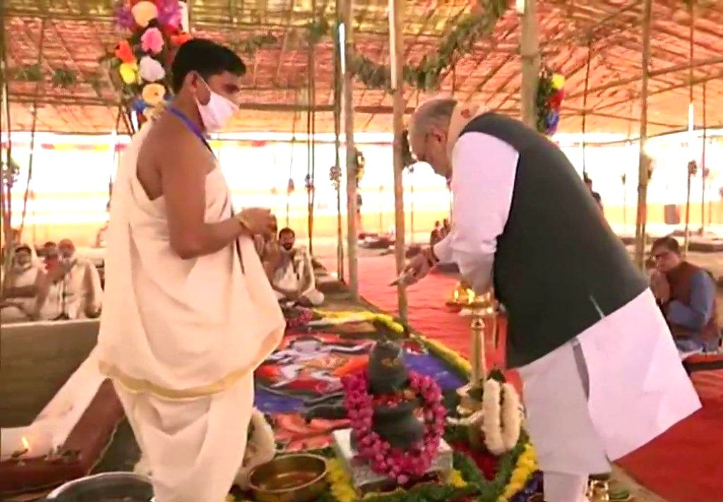 Union Home Minister Amit Shah inaugurating the beautification project of Batadrava Than and attending a public meeting alongwith Chief Minister Sarbananda Sonowal at Batadrava in Nagaon district on ... - Amit Shah