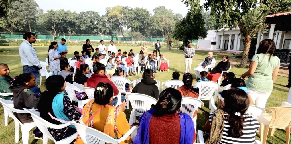 Union Home Minister Amit Shah interacts with divyang school children from Gujarat; in New Delhi on Dec 6, 2019. - Amit Shah