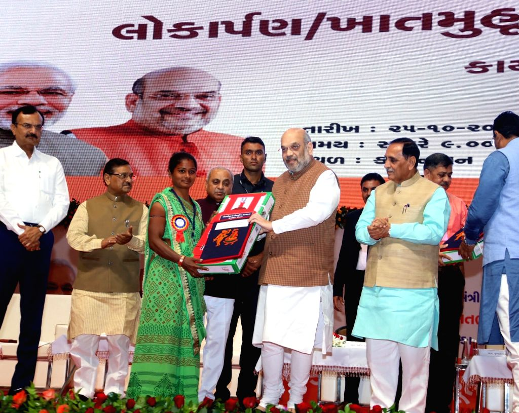 Union Home Minister Amit Shah lays the foundation stone for various development projects in Kalol of Gujarat's Gandhinagar district on Oct 25, 2019. Also seen Gujarat Chief Minister ... - Amit Shah and Nitinbhai Patel