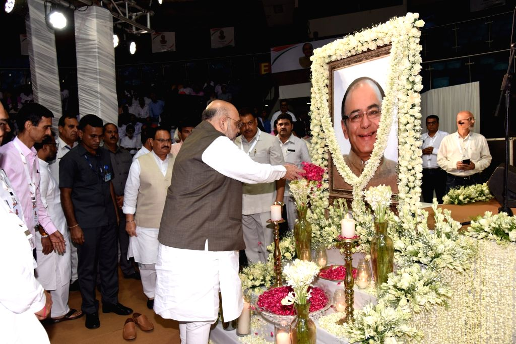 Union Home Minister Amit Shah pays tributes to former Union finance minister Arun Jaitley during a condolence prayer meet, in New Delhi on Sep 3, 2019. - Amit Shah and Arun Jaitley