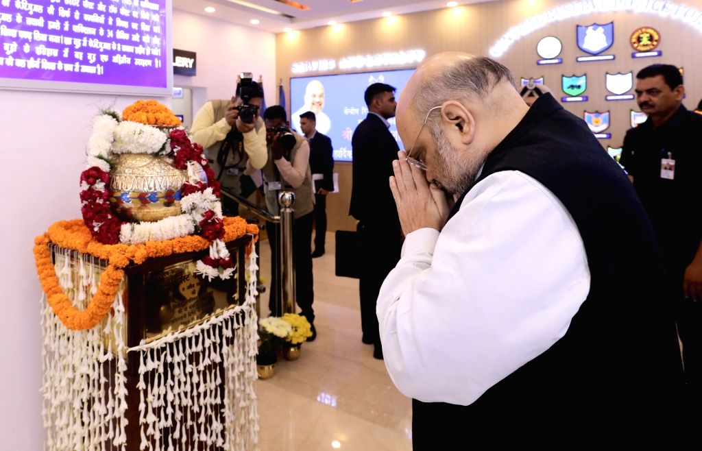 Union Home Minister Amit Shah pays tributes to CRPF jawans martyred at ???Sardar Post??? (Kutch) in Indo-Pak war of 1965, during his visit to the CRPF Headquarters, in New Delhi on Nov 15, ... - Amit Shah