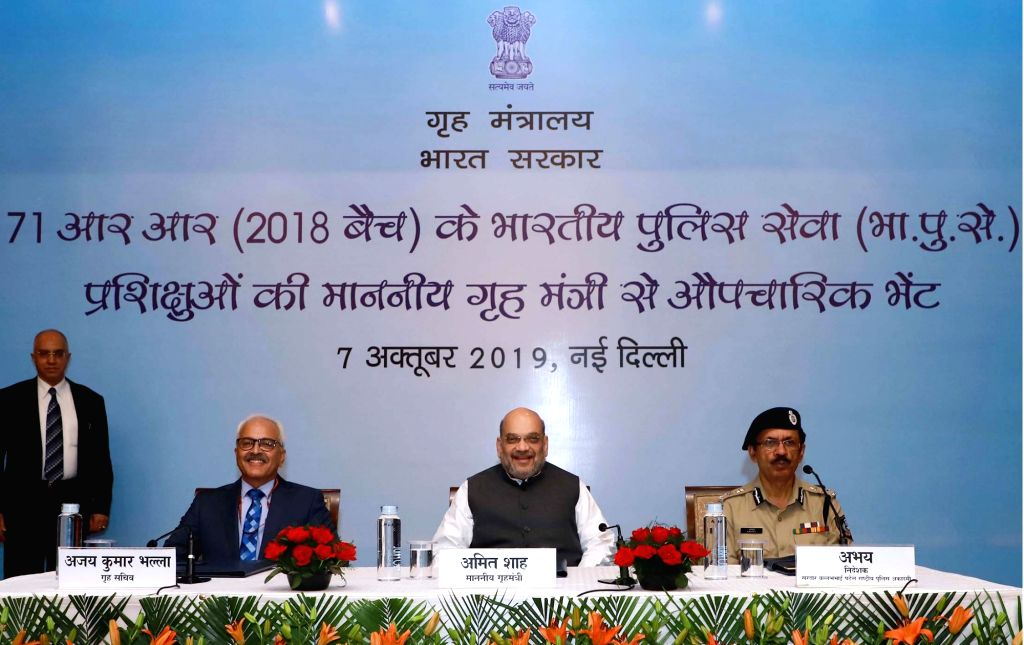 Union Home Minister Amit Shah presiding over a formal interaction with the Probationers of 2018 Batch of Indian Police Service (IPS), in New Delhi on Oct 7, 2019. Also seen Union Home ... - Amit Shah
