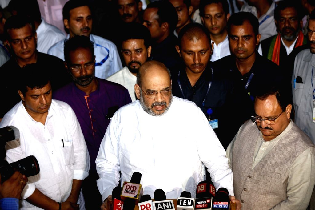 Union Home Minister Amit Shah talks to press after paying tributes to Arun Jaitley at his residence in New Delhi on Aug 24, 2019. - Amit Shah and Arun Jaitley