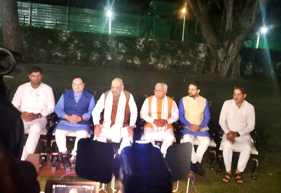 Union Home Minister Amit Shah talks to press regarding the formation of coalition government in Haryana; at his residence in New Delhi on Oct 25, 2019. Also seen BJP working President J P ... - Amit Shah and Manohar Lal Khattar