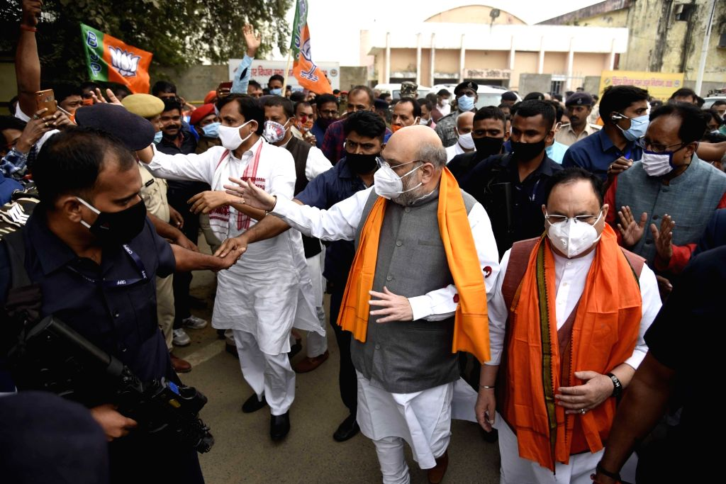 Union Home Minister Amit Shah, Union MoS Home Affairs Nityanand Rai and BJP National President JP Nadda arrive at Jaiprakash Narayan International Airport in Patna to attend the ... - Amit Shah, Affairs Nityanand Rai and Nitish Kumar