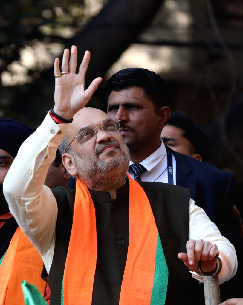 Union Home Minister Amit Shah waves at people as he holds a roadshow to campaign for BJP's electoral candidate from Hari Nagar Tajinder Pal Singh Bagga, ahead of February 8 Delhi Assembly ... - Amit Shah