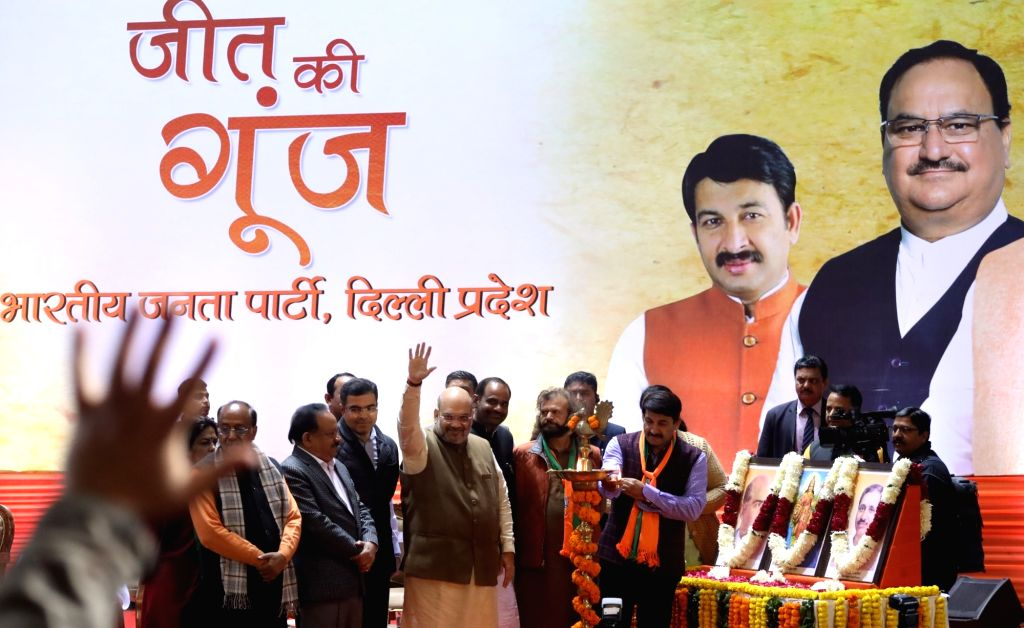 "Union Home Minister Amit Shah with BJP leaders Manoj Tiwari, Parvesh Verma, Vijay Goel, Meenakshi Lekhi, Hans Raj Hans and Ramesh Bidhuri during the party's ""Jeet Ki Goonj"" ... - Amit Shah and Parvesh Verma"