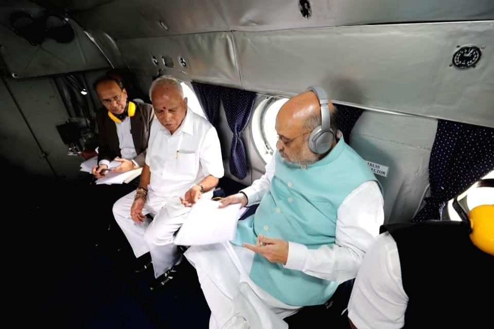 Union Home Minister Amith Shah and Karnataka Chief Minister B.S. Yediyurappa conduct aerial survey of flood hit Belagavi in Karnataka on Aug 11, 2019. - Amith Shah