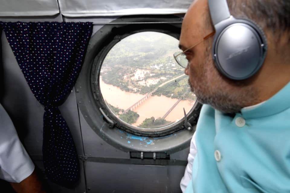 Union Home Minister Amith Shah conducts aerial survey of flood hit Belagavi in Karnataka on Aug 11, 2019. - Amith Shah