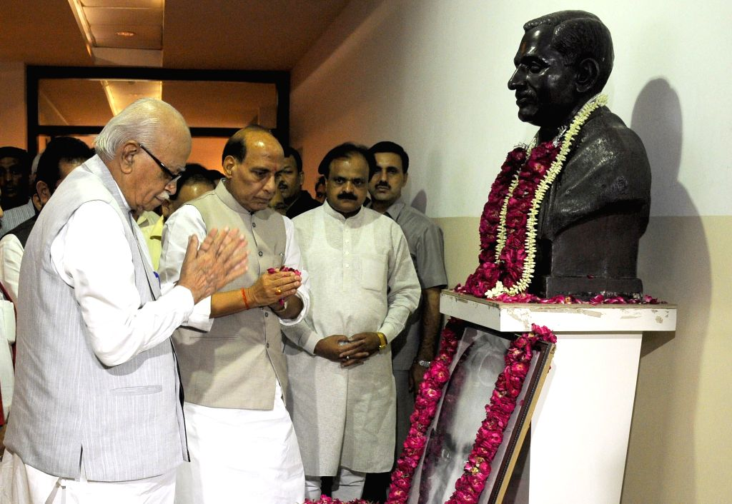 Union Home Minister and BJP chief Rajnath Singh and party veteran L K Advani pay tribute to BJP ideologue and Jana Sangh founder Shyama Prasad Mukherjee on his birth anniversary at party headquarters - Rajnath Singh, L K Advani and Shyama Prasad Mukherjee