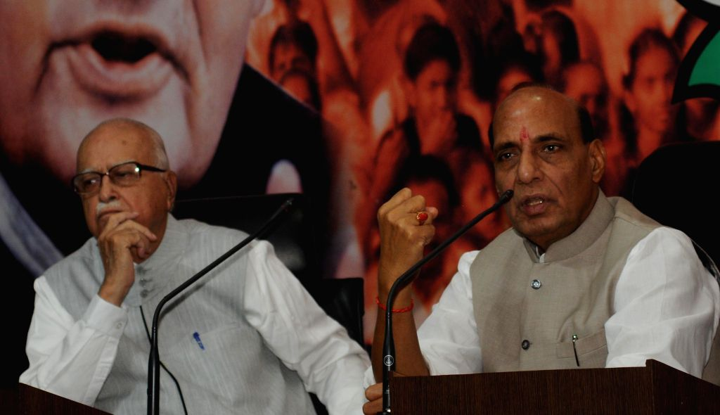 Union Home Minister and BJP chief Rajnath Singh and party veteran L K Advani during a programme organised on the birth anniversary of BJP ideologue and Jana Sangh founder Shyama Prasad Mukherjee in .. - Rajnath Singh, L K Advani and Shyama Prasad Mukherjee
