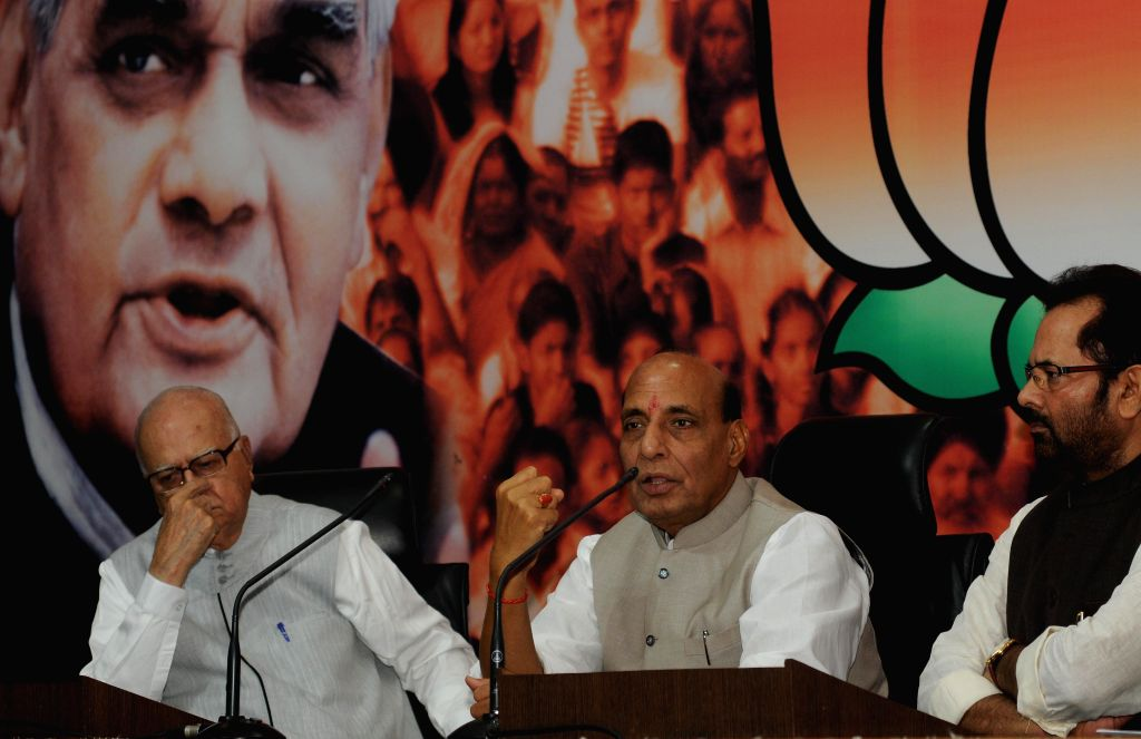 Union Home Minister and BJP chief Rajnath Singh, party veteran L K Advani and party leader Mukhtar Abbas Naqvi during a programme organised on the birth anniversary of BJP ideologue and Jana Sangh ... - Rajnath Singh, L K Advani and Shyama Prasad Mukherjee