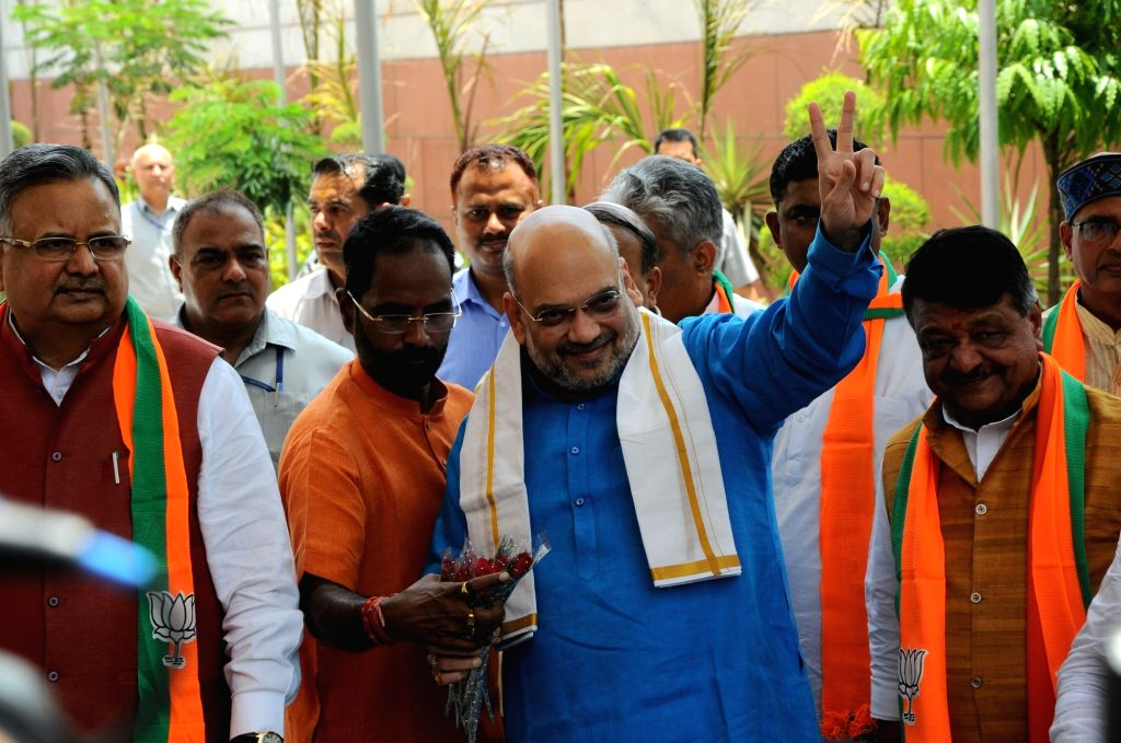 Union Home Minister and BJP President Amit Shah arrives to chair a meeting of the party's national office-bearers including state chiefs to discuss the schedule for organizational ... - Amit Shah and Raman Singh