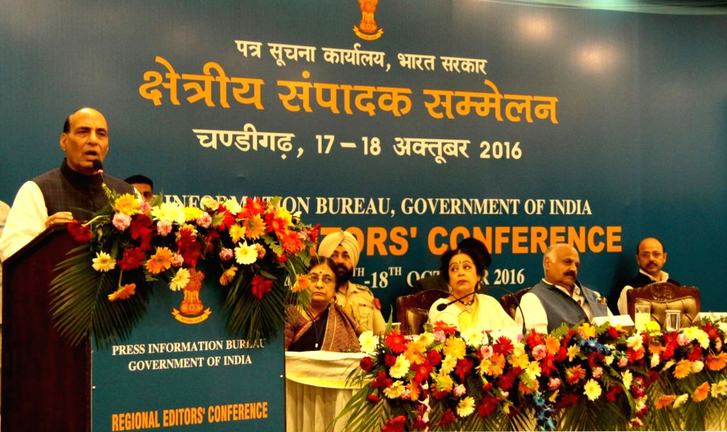 Union Home Minister Rajnath Singh addresses during the Regional Editors' conference in Chandigarh on Oct 17, 2016. Also seen Punjab Governor and Administrator of Chandigarh VP Singh ... - Rajnath Singh and Kirron Kher