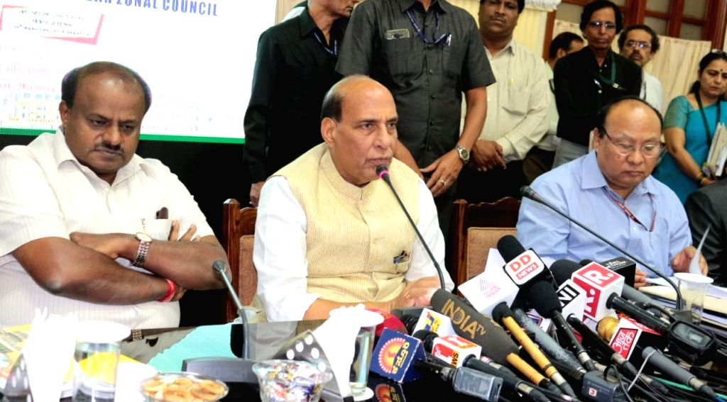 Union Home Minister Rajnath Singh addresses at the 28th Meeting of the Southern Zonal Council, in Bengaluru on Sept 18, 2018. Also seen Karnataka Chief Minister H.D. Kumaraswamy. - Rajnath Singh