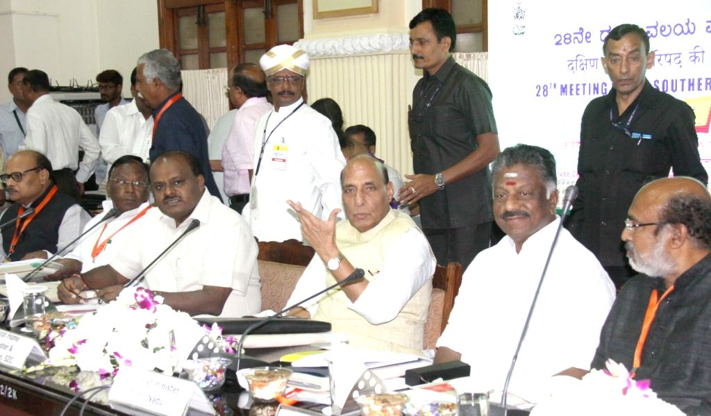Union Home Minister Rajnath Singh addresses at the 28th Meeting of the Southern Zonal Council, in Bengaluru on Sept 18, 2018. Also seen Karnataka Chief Minister H.D. Kumaraswamy, ... - Rajnath Singh