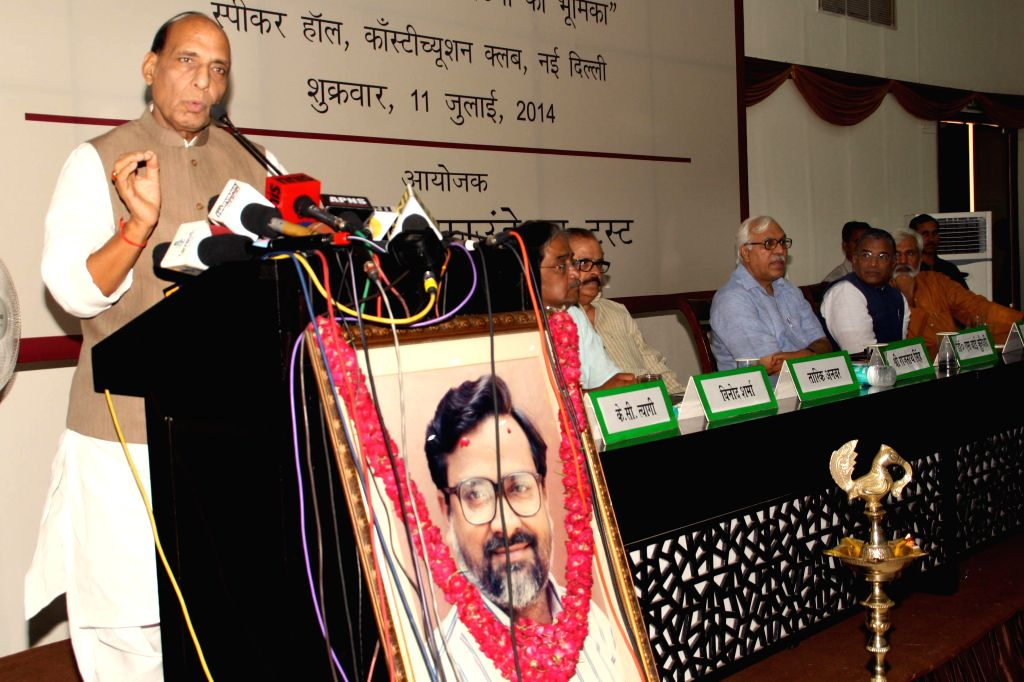 Union Home Minister Rajnath Singh addresses at a seminar organised in the memory of journalist Udyan Sharma in New Delhi on July 11, 2014. - Rajnath Singh and Udyan Sharma