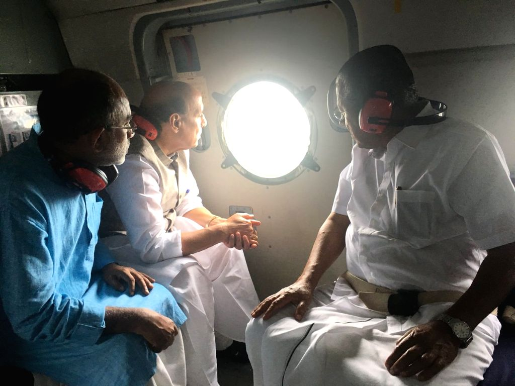 Union Home Minister Rajnath Singh along with Kerala Chief Minister Pinarayi Vijayan and Union Culture and Tourism Minister Alphons Kannanthanam, conducting the aerial survey of flood affected ... - Rajnath Singh