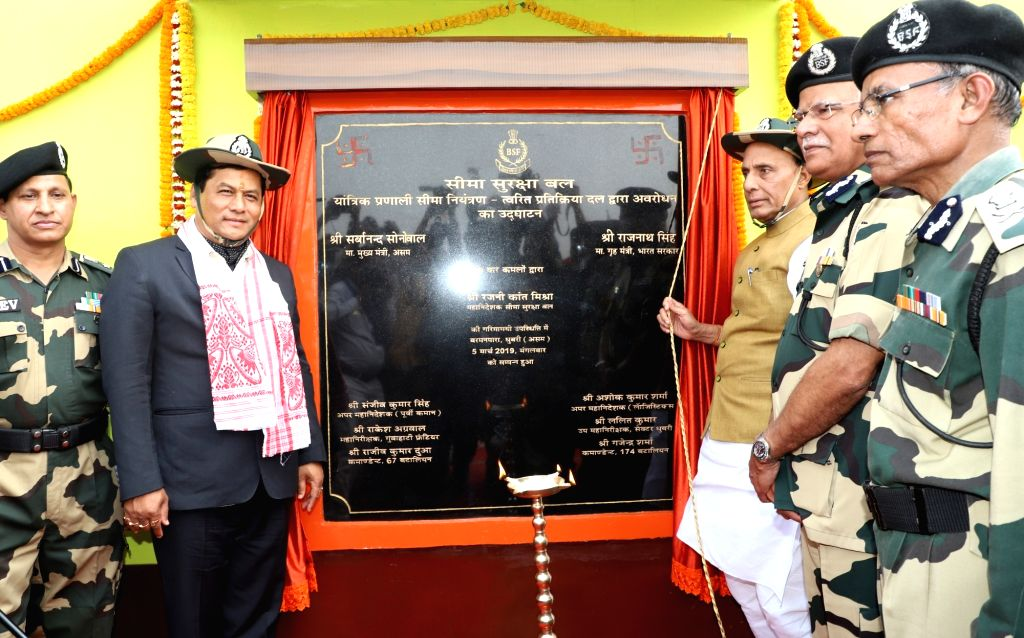 Union Home Minister Rajnath Singh along with Assam Chief Minister Sarbananda Sonowal and BSF Director General Rajni Kant Mishra unveils the plaque during the inauguration of the Comprehensive ... - Rajnath Singh and Rajni Kant Mishra