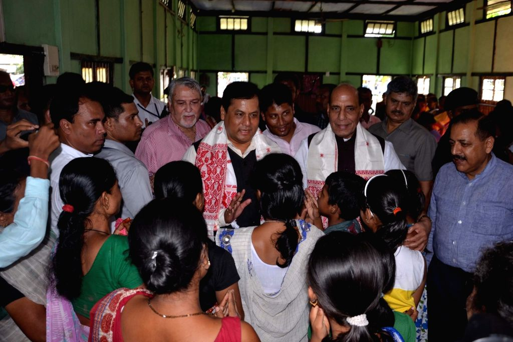 Union Home Minister Rajnath Singh and Assam Chief Minister Sarbananda Sonowal at a flood relief camp at Jagibhakatgaon in Morigaon district of Assam on July 30, 2016. - Rajnath Singh