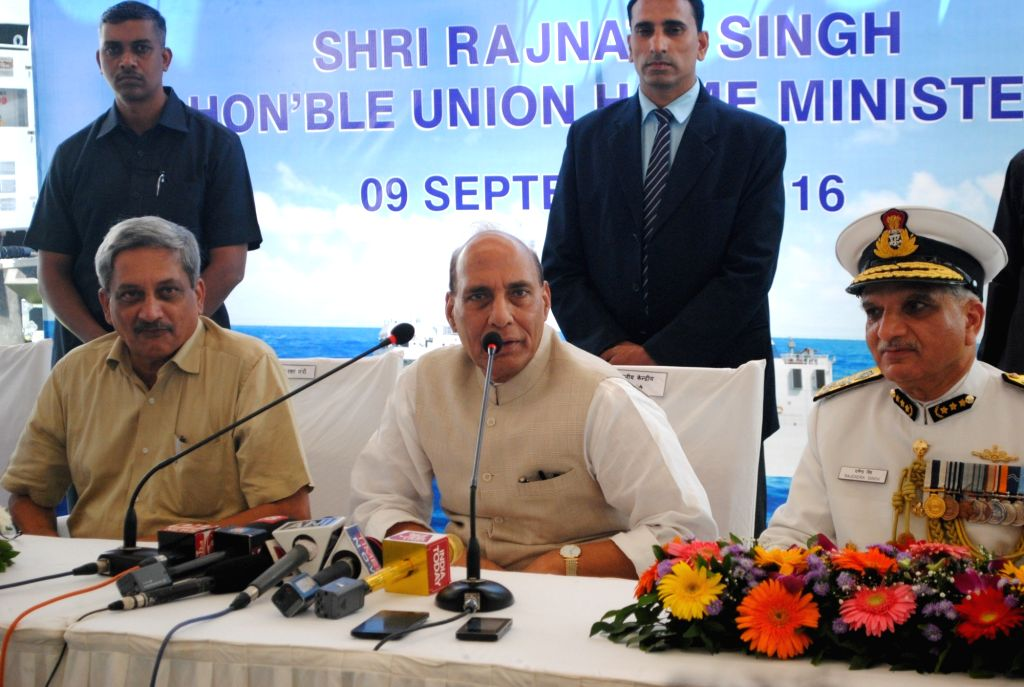 """Union Home Minister Rajnath Singh and Defence Minister Manohar Parrikar during a press conference during a programme organised to commission Coast Guard's """"ICGS Sarthi""""  at Goa ... - Rajnath Singh and Rajendra Singh"""