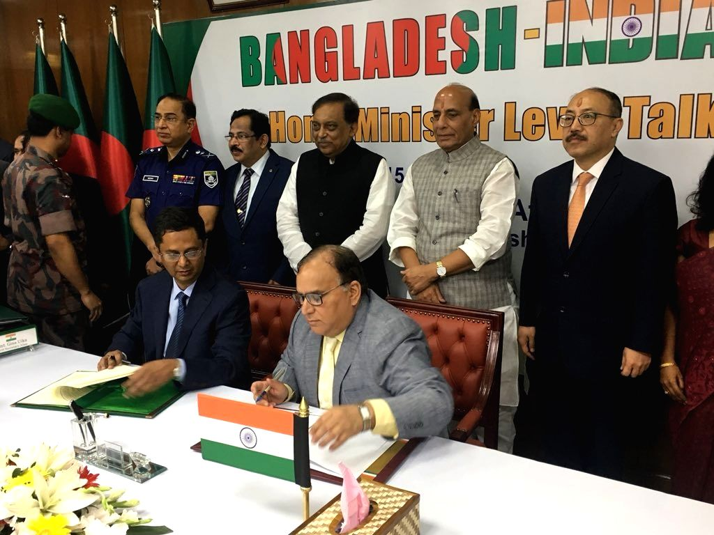 Union Home Minister Rajnath Singh and his Bangladeshi counterpart Asaduzzaman Khan witness the signing of Revised Travel Arrangement (RTA)-2018 between India and Bangladesh, in Dhaka on July ... - Rajnath Singh and Asaduzzaman Khan