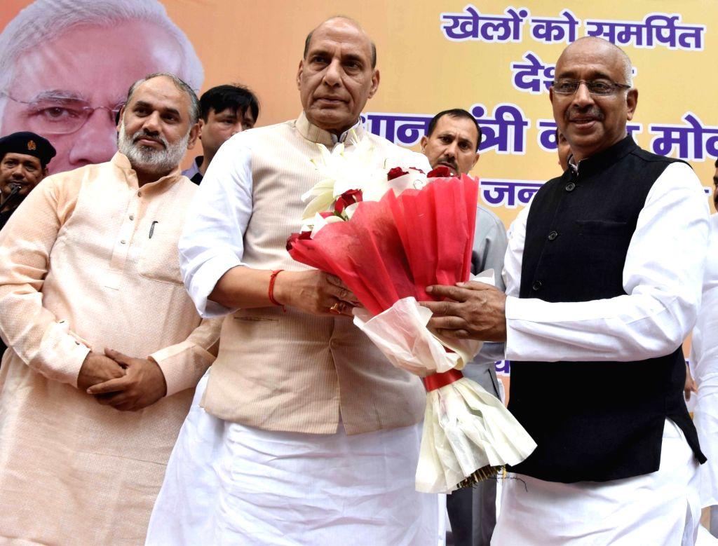 "Union Home Minister Rajnath Singh and Minister of State (I/C) for Youth Affairs and Sports Vijay Goel during ""Khel Vikas Daud"" organised on the occasion Prime Minister Narendra ... - Rajnath Singh and Narendra Modi"