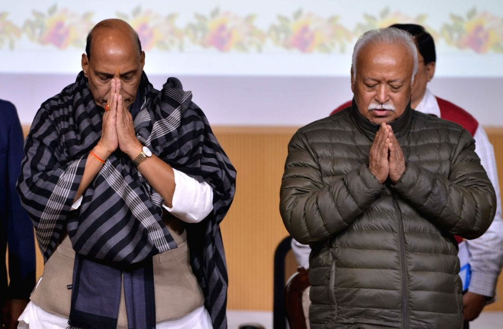 Union Home Minister Rajnath Singh and Rashtriya Swayamsevak Sangh (RSS) chief Mohan Bhagwat during a condolence meeting organised to pay tributes to writer Devendra Swaroop in New Delhi, ... - Rajnath Singh