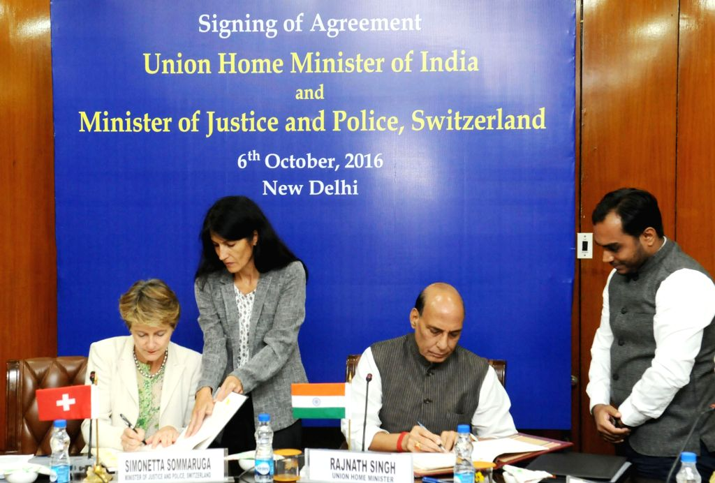 Union Home Minister Rajnath Singh and the Minister for Justice and Police of Swiss Confederation Simonetta Sommaruga signs an agreement in New Delhi on Oct 6, 2016. - Rajnath Singh