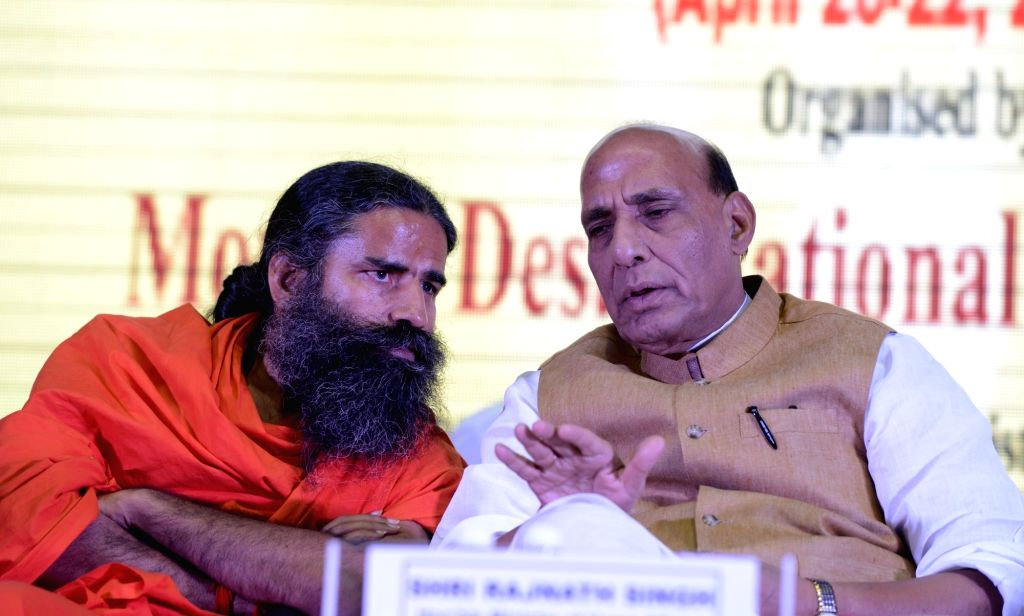 Union Home Minister Rajnath Singh and Yoga Guru Ramdev during International Yoga Fest in New Delhi, on April 22, 2016. - Rajnath Singh