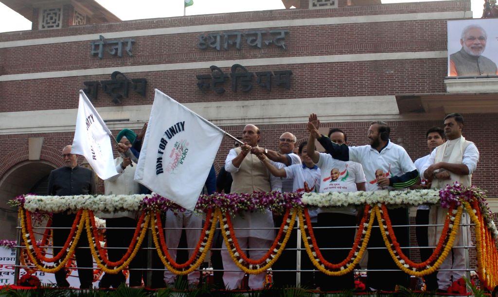 Union Home Minister Rajnath Singh at the flag off ceremony of Run For Unity on Rashtriya Ekta Diwas at Major Dhyan Chand National Stadium, in New Delhi on Oct 31, 2018. Also seen Union ... - Rajnath Singh, Harsh Vardhan, Hardeep Singh Puri and Prakash Javadekar