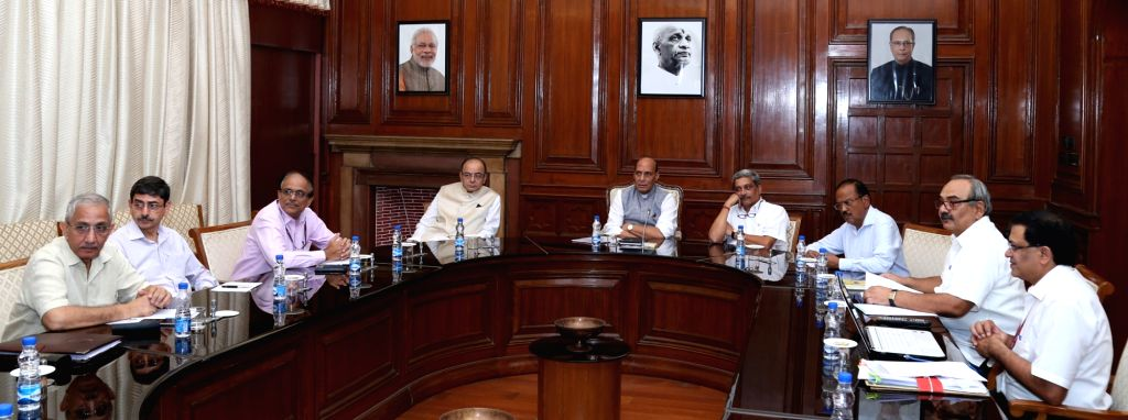 Union Home Minister Rajnath Singh chairs a meeting to review the situation of Jammu and Kashmir, in New Delhi on August 5, 2016. Also seen Union Minister for Finance and Corporate Affairs ... - Rajnath Singh and Affairs Arun Jaitley