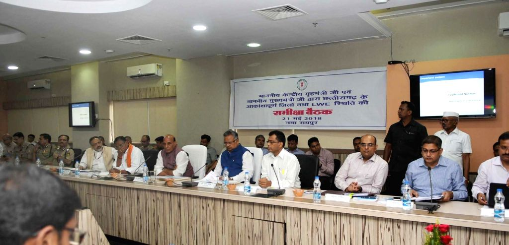 Union Home Minister Rajnath Singh chairs a meeting to review the Left Wing Extremism (LWE) situation and the progress of 'Aspirational Districts', in Raipur on May 21, 2018. Also seen ... - Rajnath Singh and Raman Singh