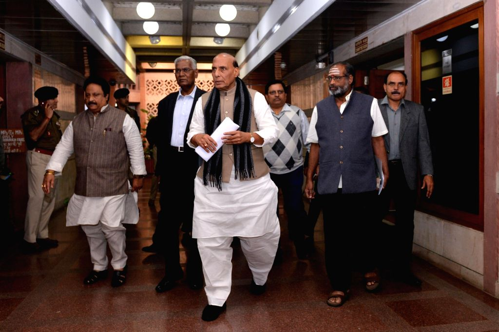 Union Home Minister Rajnath Singh, CPI leader D. Raja and other party leaders depart after the all party meeting on Pulwama terror attack at Parliament House, in New Delhi, on Feb. 16, ... - Rajnath Singh