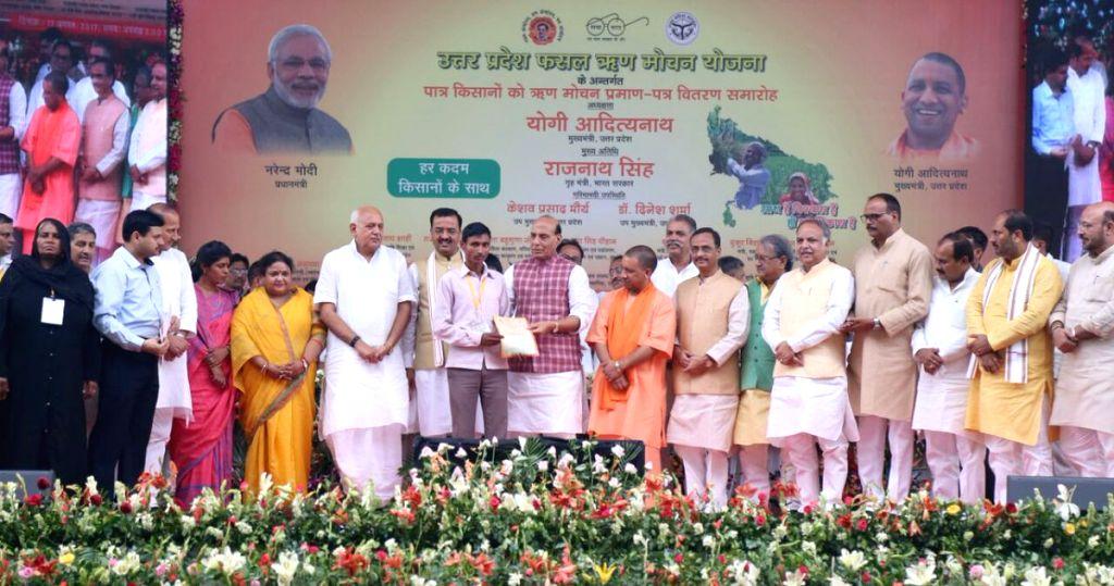 "Union Home Minister Rajnath Singh distributes the Loan Waiver Certificate to the farmers under ""Fasli Rin Mochan Yojana"" in Lucknow on Aug 17, 2017. Also seen Uttar Pradesh Chief ... - Rajnath Singh"