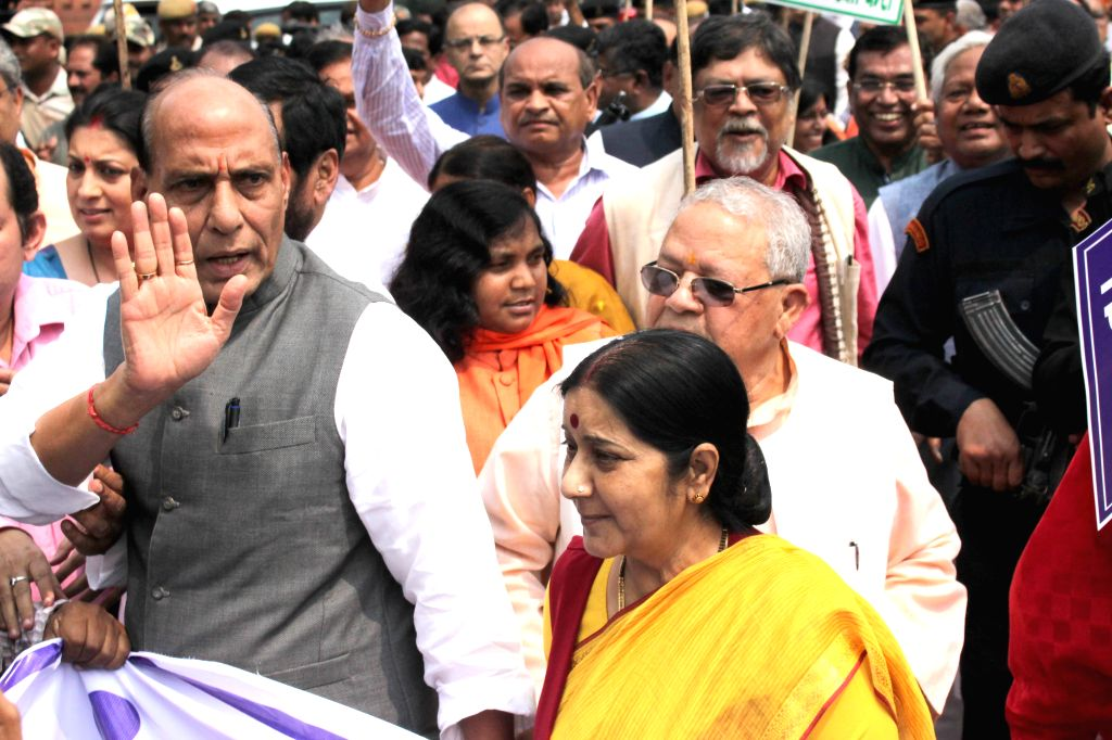 Union Home Minister Rajnath Singh, External Affairs Minister Sushma Swaraj and other NDA MPs participate in `Save Democracy` rally at Vijay Chowk  in New Delhi, on Aug 13, 2015. - Rajnath Singh and Sushma Swaraj