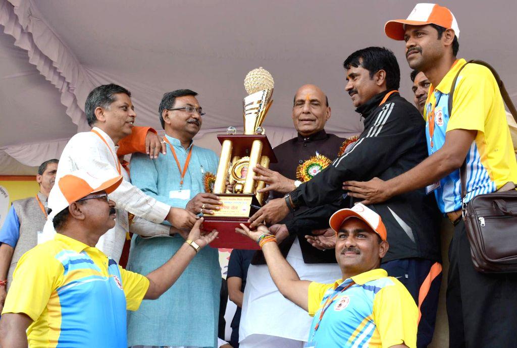 Union Home Minister Rajnath Singh gives away trophies at the 31st National Sports ceremony organised by Vidya Bharti Akhil Bhrtiya Shiksha Sansthan, in Lucknow on Nov 2, 2018. - Rajnath Singh